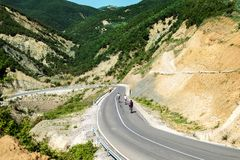 Cyclist riding bikes on open road. stock photos