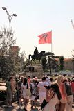 Tirana, Albania, August 2013. A group of tourists in front of the monument to the national hero. royalty free stock photography