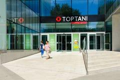Entrance to large modern shopping center Toptani, Tirana, Albania. TIRANA, ALBANIA - SEPTEMBER 6, 2017: Unknown people visit large modern shopping center Toptani royalty free stock photography