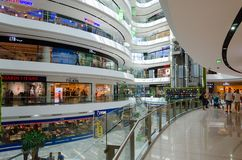 Interior of large modern shopping center Toptani, Tirana, Albania. TIRANA, ALBANIA - SEPTEMBER 6, 2017: Unknown people visit large modern shopping center Toptani Stock Photo