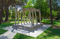 Monument to victims of political repression, Tirana, Albania. TIRANA, ALBANIA - SEPTEMBER 6, 2017: Unknown people walk in park on boulevard of Martyrs near Royalty Free Stock Photo