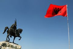 Tirana, Albania, Skanderbeg Monument and National Flag. Skanderbeg's monument, Tirana, Albania and Albanian national flag flying royalty free stock photos