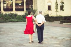 Tirana main. Grown up dughter walking with her old father in Tirana city center Royalty Free Stock Images