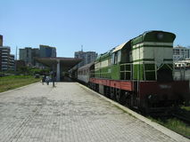 Tirana Railway Station, Tirana, Albania. A train for Durres waits to depart from Tirana railway station, Tirana Albania. The train is made up of damaged former Stock Photography