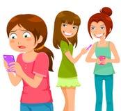 Tiranizar através do telefone celular Foto de Stock Royalty Free