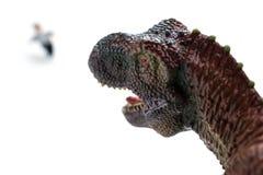 Tirannosauro che insegue una gente corrente Fotografia Stock