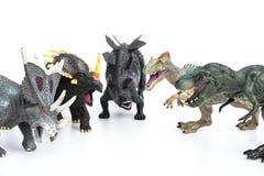 Tirannosauro e stegosauro e styracosaurus e allosauro Immagini Stock