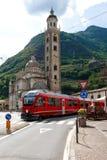 Tirano, Italy. Swiss mountain train Bernina Express arrive at Italian city Tirano Royalty Free Stock Images
