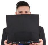 Tirante con un computer portatile Immagine Stock