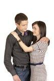 Tirante con una ragazza che si leva in piedi in un abbraccio Fotografia Stock Libera da Diritti