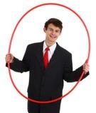 Tirante di affari che passa attraverso un cerchio Immagine Stock Libera da Diritti