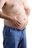 Tirante grasso che tiene la sua grande pancia Immagine Stock Libera da Diritti