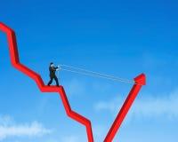 Tirare su scendere la freccia rossa Fotografie Stock