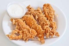 Tiras curruscantes del pollo Fotografía de archivo