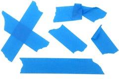 Tiras da pintura ou da fita de máscara azul fotografia de stock