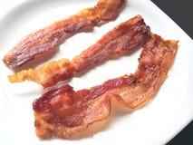 Tiras de bacon friáveis fritadas Imagem de Stock