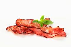 Tiras de bacon fritadas bandeja Fotografia de Stock Royalty Free