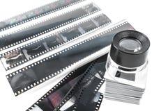 Tiras de la diapositiva, de la lupa y de la película Imagen de archivo libre de regalías