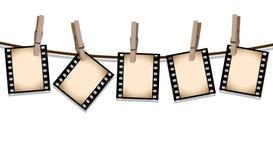 Tiras de la película de la sepia que cuelgan hacia fuera para secarse Imagen de archivo