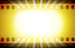 Tiras de la película y rayos ligeros Foto de archivo