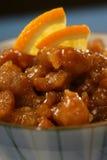 Tiras de pecho de pollo con el azúcar y la naranja   Fotos de archivo
