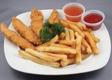 tiras e fritadas da galinha combinados imagem de stock