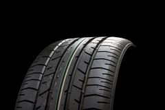 Tire. Brand new car tire on black background Stock Photo