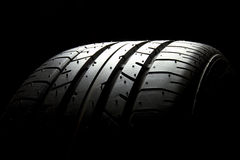 Tire. Brand new car tire on black Stock Photo