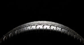 Tire. Brand new car tire on black with a lot of space for text Stock Images