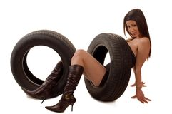 Tire. Young girl with a car wheel