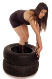Tire. Young sexy girl with two a car wheel Royalty Free Stock Image