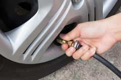 Tire air pressure checking Royalty Free Stock Images