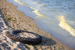 Tire on a beach Stock Images