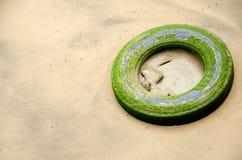 Tire on the beach Stock Photos
