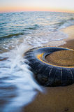 The tire on the beach Royalty Free Stock Images