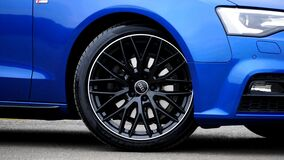 Tire on blue Audi car stock photo