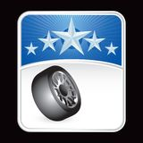 Tire on blue star background Stock Photo