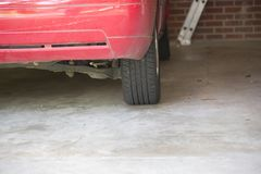 Tire and Bumper. Of a car in a garage Royalty Free Stock Photos