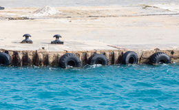 Tire Bumpers on Concrete Pier Stock Image
