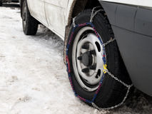 Tire chain. Mounted on a tire in snowy weather Stock Photography