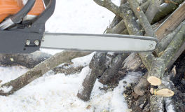 Tire chain saws in operation, cutting firewood Stock Images