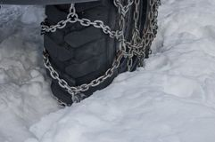 Tire with chains. Tire with snow chains stock image