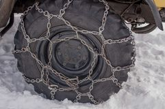 Tire with chains. The tire with snow chains royalty free stock photography