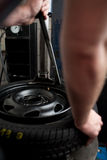 Tire change closeup. Mechanic changing a car tire closeup Stock Photos