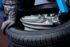 Tire change closeup Stock Photos
