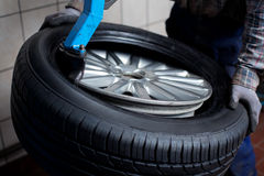 Tire change closeup Royalty Free Stock Images