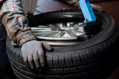 Tire change closeup Royalty Free Stock Photo