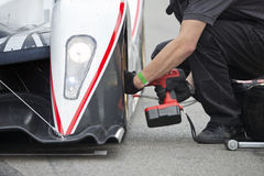 Tire change during pitstop Royalty Free Stock Photo