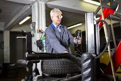 Tire change technician Stock Photo
