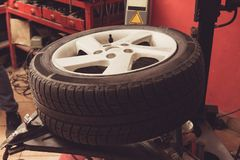 Tire close up on balancing machine - change tire in auto repair royalty free stock photos